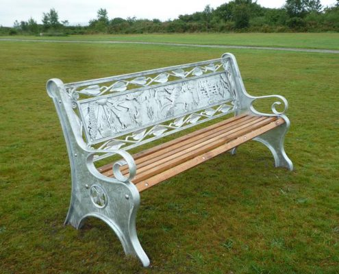 Bodmin Beacon Park heritage benches made of metal with oak seat slats in park land. Made by Thrussells. Public Art Cornwall