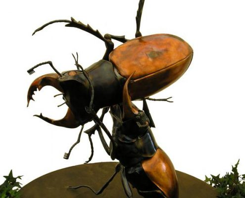 Two giant fighting Stage Beetles made of copper and steel. Made by Thrussells