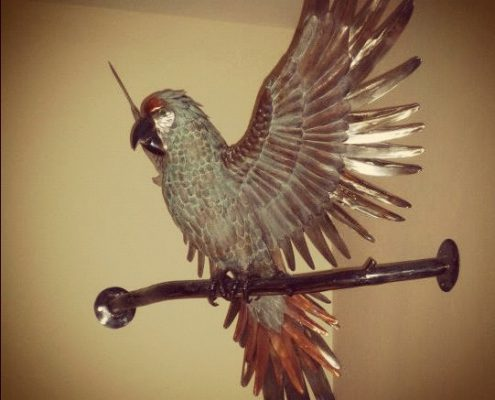 Copper Green Parrot sculpture for Wetherspoons in Perronporth. Made by Thrussells