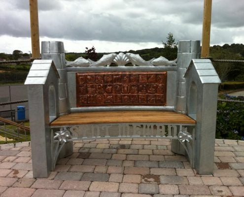 Cornish heritage, fishing and mining themed bench made of metal and oak. Made by Thrussells. Public Art Cornwall