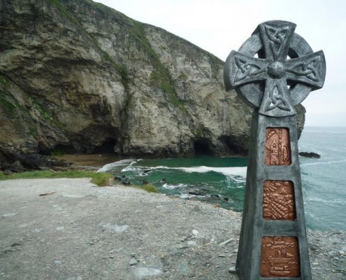 Steel and copper Celtic cross designed and made with Penrice Collage. Made by Thrussells. Public Art Cornwall