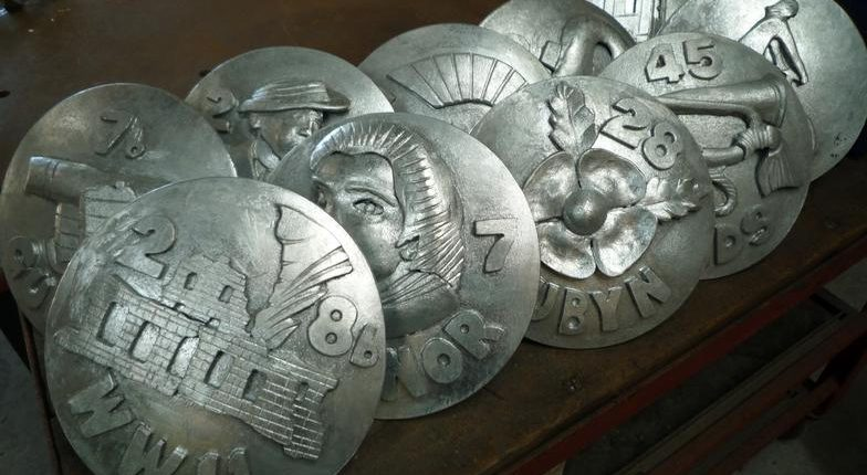 Devonport Heritage Trail, eighty metal plaques installed across town of Devonport. photo depicts ten plaques with relief metal imagery installed in 2010. Made by Thrussells. Plymouth public art