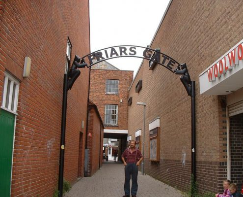 Metal archway between two building marks the entrance to Maldon town centre. Made by Thrussells. Public Art Essex