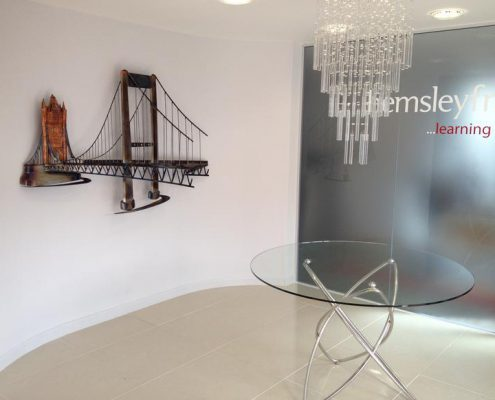 copper and steel wall sculpture of Tamar bridge and London Tower bridge. Made by Thrussells