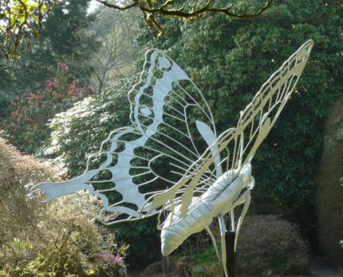 Giant metal Butterfly sculpture in garden