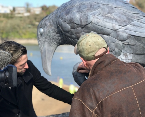 Thomas and Gary are filmed while explain how the Rook sculpture was made.