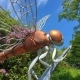 head, torso legs of a dragonfly sculpture made of copper and steel.