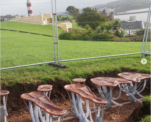Open hole on Plymouth Hoe as new BeatleBums are installed on the seafront. Plymouth public art