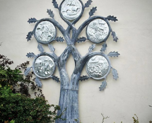 tree sculpture mounted on wall depicts local history of billericay town. Made by Thrussells