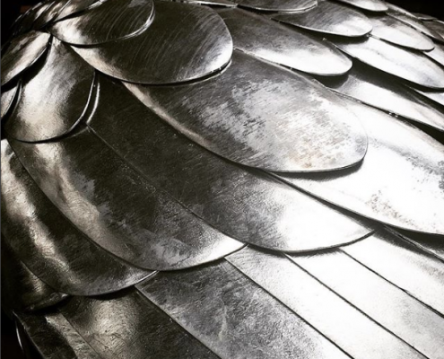steel feathers on the back of a giant bird sculpture. Made by Thrussells