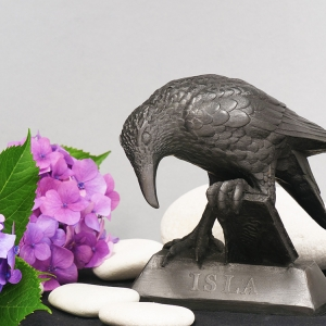small resin statue of 'Rook With A Book' sat a Hydrangeas