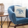 Square 50x50 cushion with Thrussells blue bird on chair