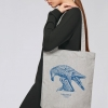 Woman with heather grey tote bag with Thrussells blue bird