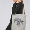 Woman with heather grey tote bag with Thrussells grey bird