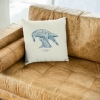 Square 50x50 cushion with Thrussells blue bird in living room