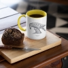 Two tone white and yellow mug with Thrussells grey bird with coffee and cake