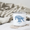 White enamel mug with Thrussells blue bird in living room