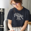 Woman reading with navy blue t-shirt with Thrussells cream bird