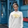 Woman with white sweatshirt with Thrussells yellow bird