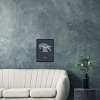 Black wooden A3 frame print with Thrussells cream bird on navy blue by sofa