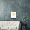 Black wooden A3 frame print with Thrussells yellow bird by sofa