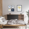 Black wooden A3 frame print with Thrussells yellow bird in collection in bedroom